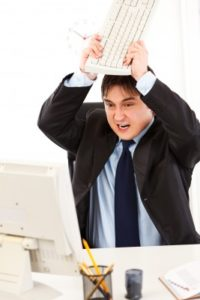 man angry at computer-facility-management-consulting-consultant-cmms-facilities-training-education-ifma-fm360-rimer
